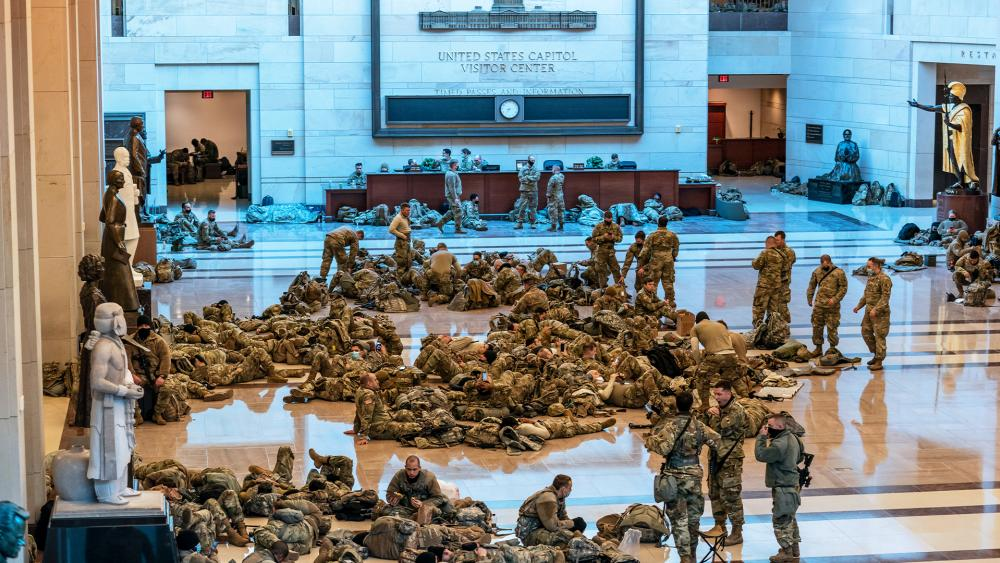 Hundreds of National Guard troops hold inside the Capitol Visitor's Center to reinforce security at the Capitol in Washington, Wednesday, Jan. 13, 2021. (AP Photo/J. Scott Applewhite)