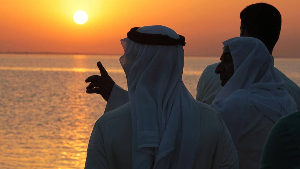 The Persian Gulf at sunset as seen from the western village of Karzakan, Bahrain. (AP Photo/Hasan Jamali)
