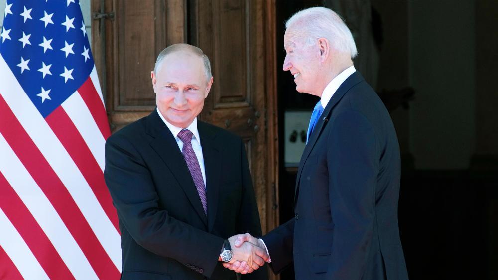 Russian President Vladimir Putin, left, and U.S President Joe Biden shake hands during their meeting at the 'Villa la Grange' in Geneva, Switzerland in Geneva, Switzerland, June 16, 2021. (AP Photo/Alexander Zemlianichenko, Pool)