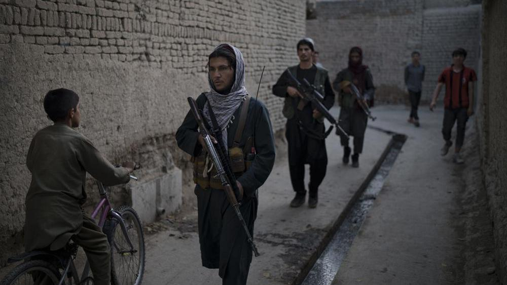 Taliban fighters patrol a neighborhood in search for a man accused in a stabbing incident, in Kabul, Afghanistan. (AP Photo/Felipe Dana)