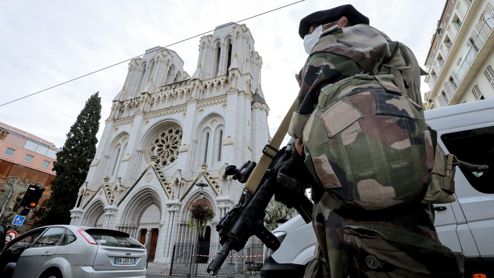 A soldier patrols outside Notre Dame church in Nice, southern France, Thursday, Oct. 29, 2020. An attacker armed with a knife killed three people inside a church in the Mediterranean city of Nice (Eric Gaillard/Pool via AP)