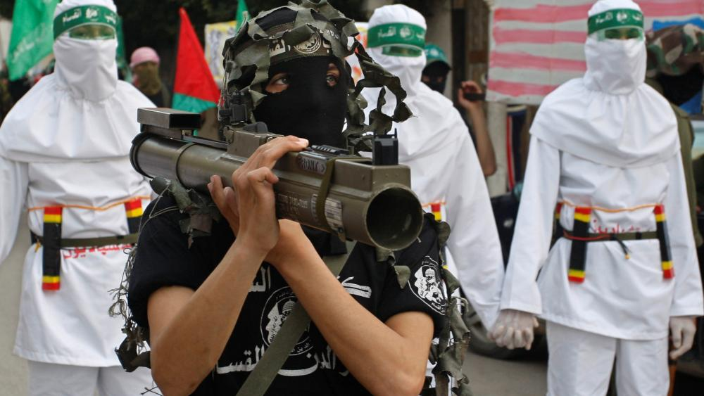A masked Palestinian Hamas member holds a weapon during a demonstration to show solidarity with Sudan, in the Bureij refugee camp, central Gaza Strip, Friday, March 6, 2009. (AP Photo/Hatem Moussa)