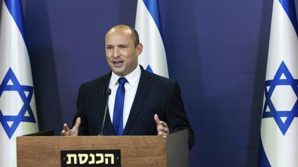 Yemina party leader Naftali Bennett speaks to the Israeli Parliament in Jerusalem, Sunday, May 30, 2021. (Yonatan Sindel/Pool via AP)