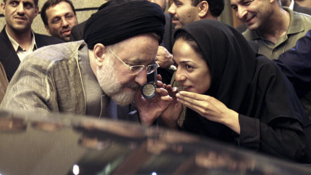 In this July 13, 2005, file photo, outgoing reformist Iranian President Mohammad Khatami talks on the phone with the mother of female journalist Masih Alinejad, right, after meeting with journalists in Tehran, Iran. (AP Photo/Hasan Sarbakhshian, File)