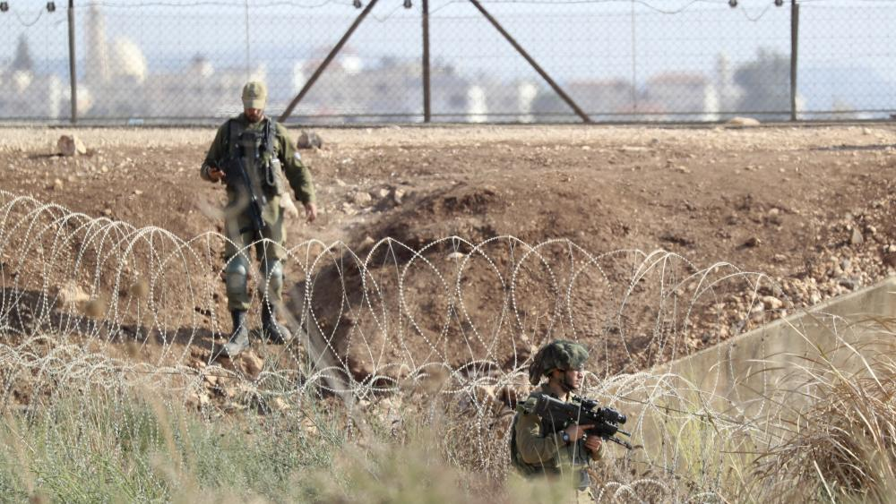 In this Sept. 12, 2021, file photo, Israeli soldiers take positions along the border between the northern West Bank near Jenin and Israel as they search for two Palestinians who broke out of a maximum-security prison. (AP Photo/Ariel Schalit, File)