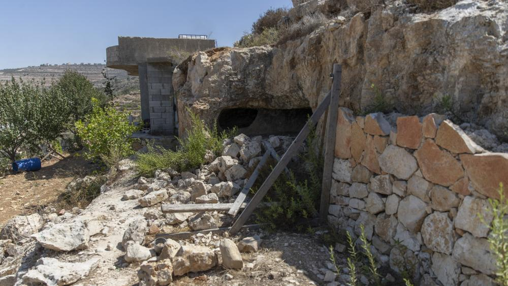 This photo shows a scene after an Israeli army operation that left a few Palestinian men killed, in the West Bank village of Beit Anan, west of Ramallah, Sunday, Sept. 26, 2021. (AP Photo/Nasser Nasser)