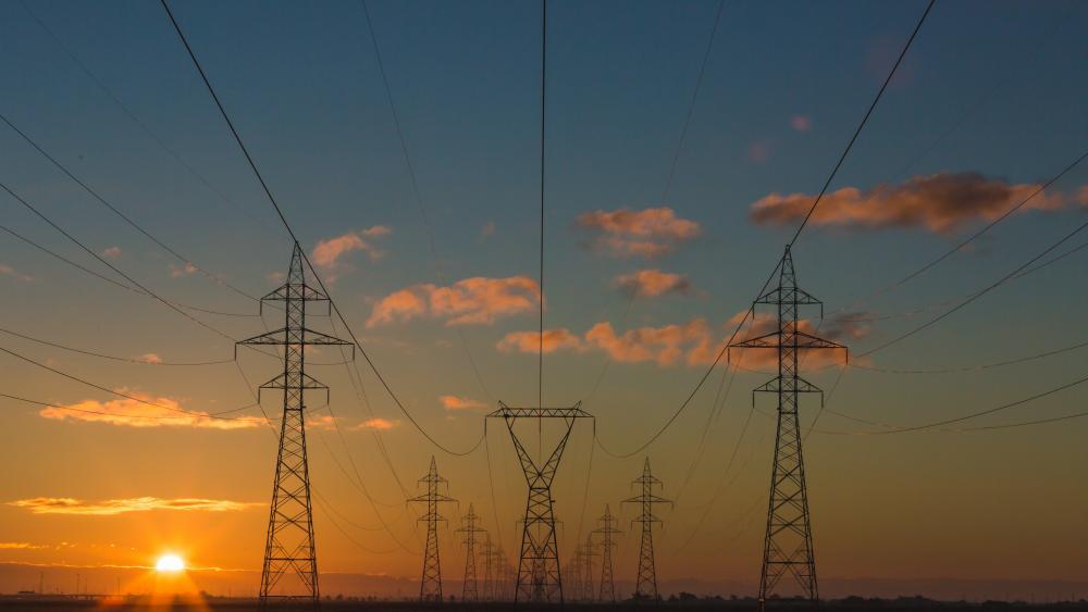 Power pylons at sunset. Unsplash.