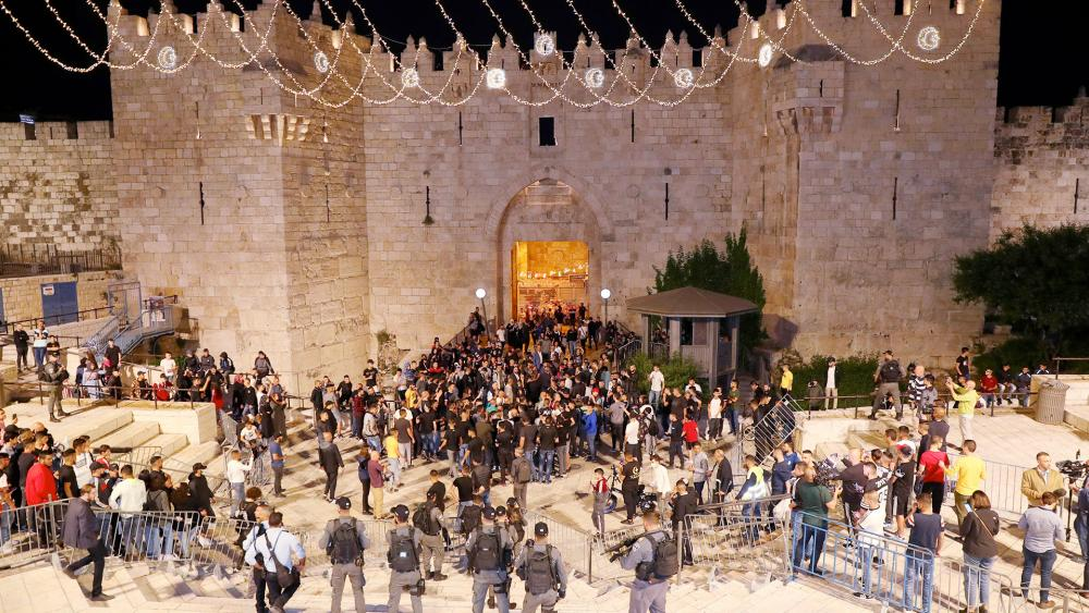 Palestinians celebrates after Israel's police removed barricades in a plaza outside of Jerusalem's Old City, Sunday, April 25, 2021. (AP Photo/Ariel Schalit)