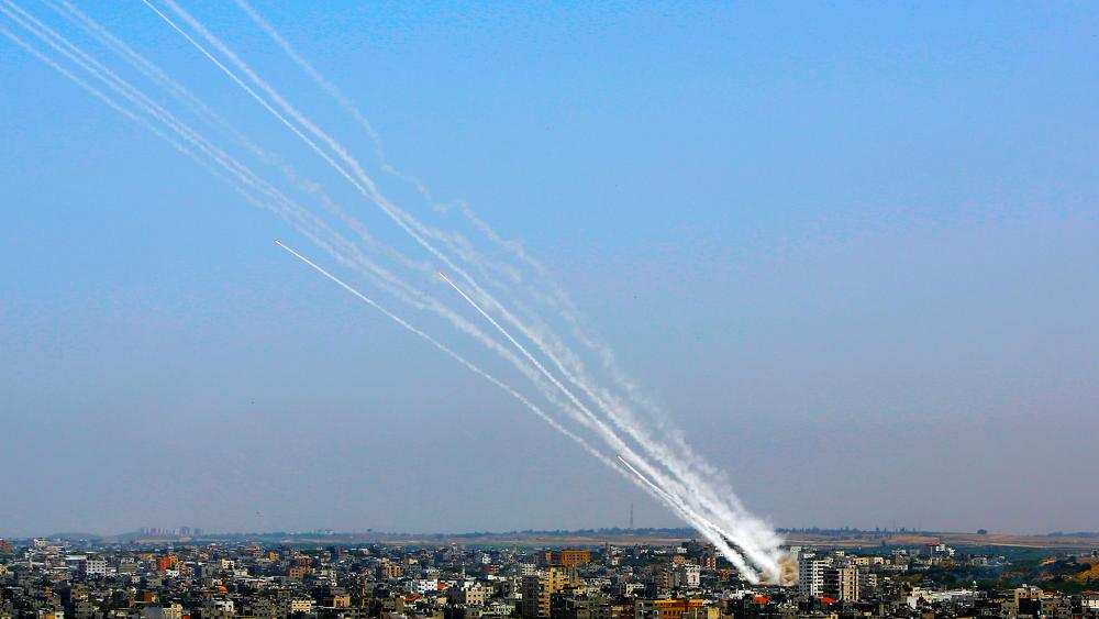 Rockets are launched from Gaza Strip towards Israel, Tuesday, May 11, 2021. (AP Photo/Hatem Moussa)